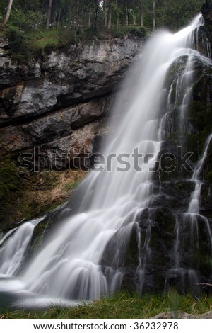 Long exposure waterfall in austrian alps - stock photo