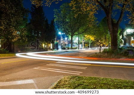 Long exposure with headlight trail - stock photo