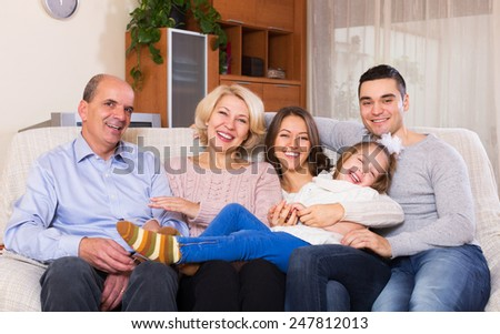 Long family with grand children posing indoors - stock photo