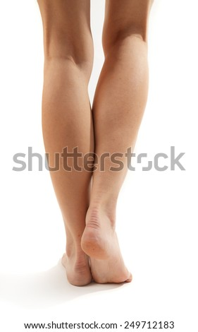 Long female legs isolated - stock photo