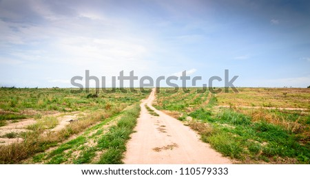 Long  footpath leads up a hill to the distant horizon - stock photo