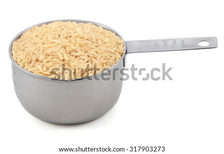 Long grain brown rice in an American measuring cup, isolated on a white background - stock photo