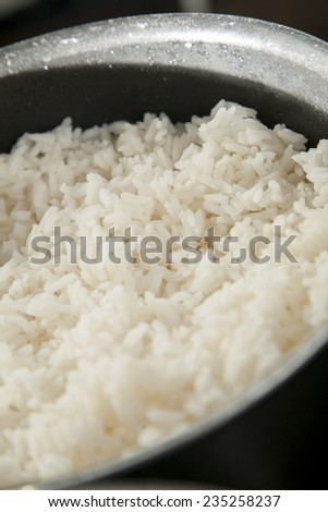 Long grain white rice being cooked in a pot - stock photo