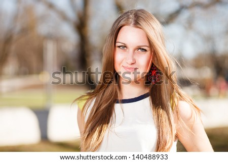 Long hair girl`s portrait outdoor. - stock photo