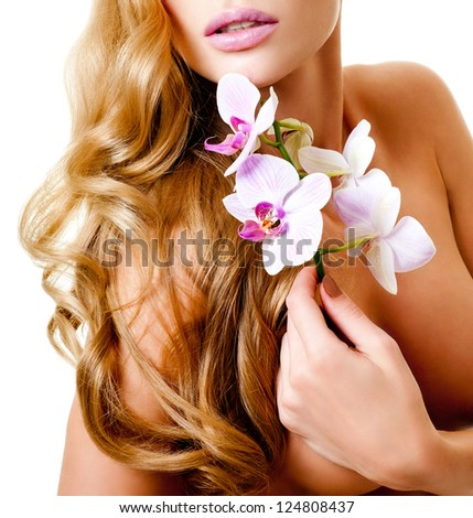 long-haired blonde with pink orchids - stock photo