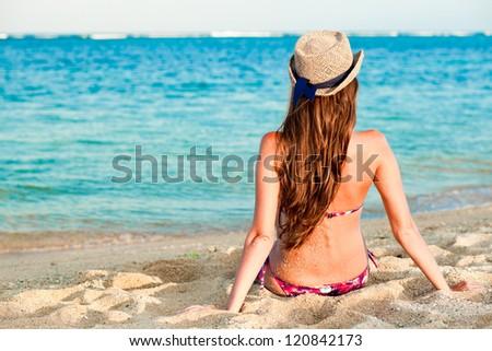 long haired girl in bikini on tropical bali beach - stock photo