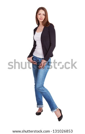 Long-haired girl in jeans and a dark sweater - stock photo