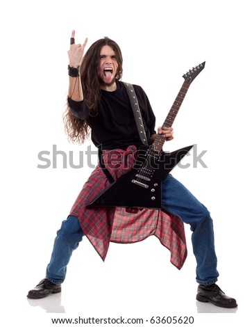 long haired guitarist is playing and making a rock hand gesture - stock photo