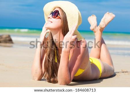 long haired happy young woman in bikini smiling on tropical Boracay beach - stock photo