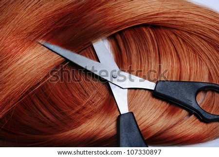 Long healthy red hair and professional scissors - stock photo