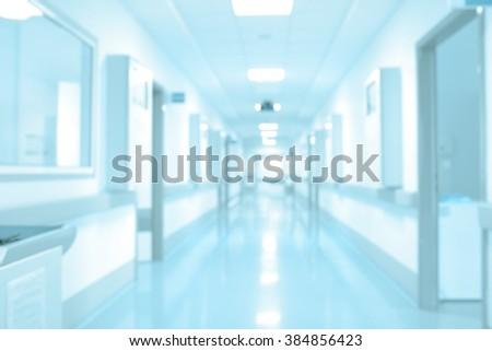 Long hospital hallway, background unfocused. - stock photo