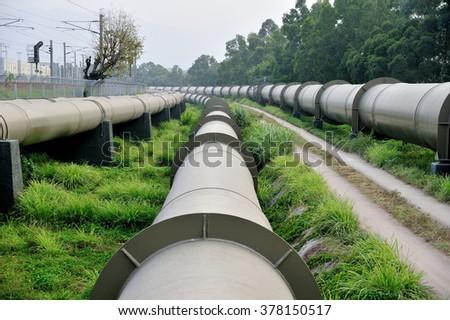 Long huge water pipes in Hong Kong - stock photo