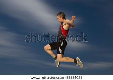 long jump in track and field - stock photo