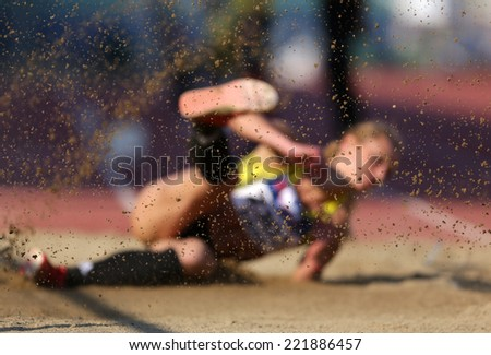 Long jump with sand on focus. - stock photo