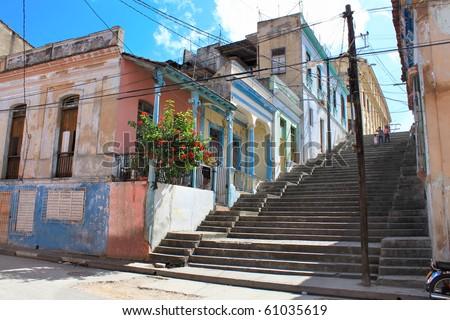 Long Padre Pico staps with crumbling buildings in Santiago de Cuba , Cuba - stock photo