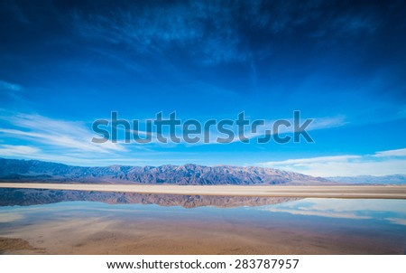 Long panoramic view of landscapes stretching into the distance in Death Valley National Park. - stock photo