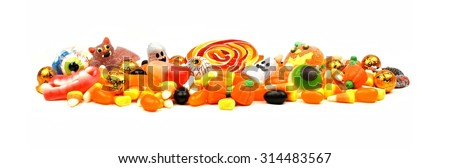 Long pile of colorful Halloween candy and sweets over a white background - stock photo
