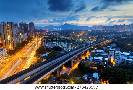 Long Ping, hong kong urban downtown and high speed train at night - stock photo