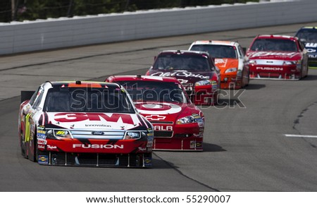 LONG POND, PA - JUNE 06: Greg Biffle races off turn three for the Gillette Fusion ProGlide 500 race at the Pocono Raceway in Long Pond, PA on June 06, 2010. - stock photo