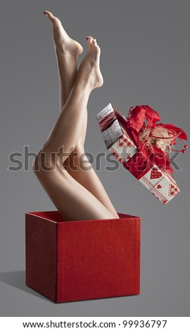 Long pretty woman naked legs isolated with a fashion light - stock photo