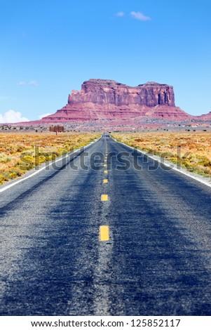 Long Road to Monument Valley, Arizona, USA - stock photo