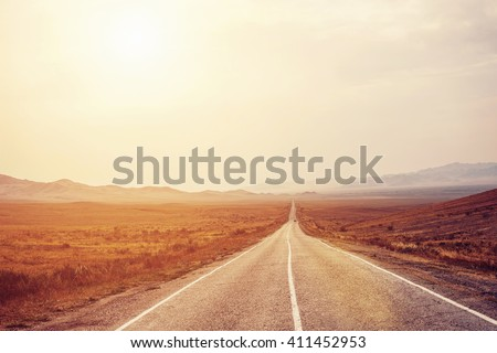 Long Road to mountains horizon. Big way for car travel - stock photo
