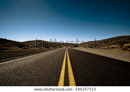 Long road to the nomad, clear sky - stock photo