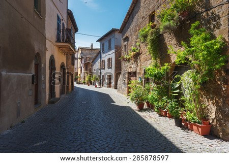 Long shadows on the streets of Italian cities in sunny Tuscany. - stock photo