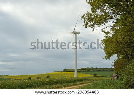 Long shot on 1 wind turbine in the middle of field in country. - stock photo