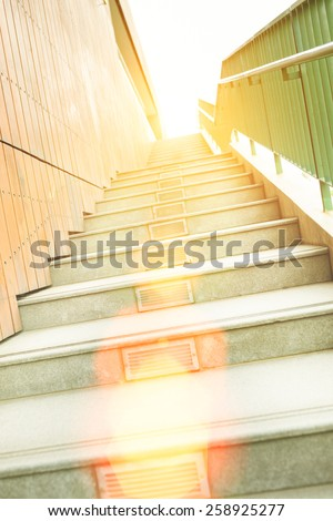 Long stairs up to modern building with sunshine - stock photo