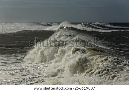 Long stormy breaking waves. North of Portugal coast. - stock photo