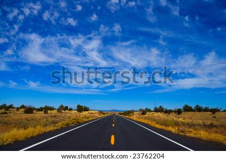 Long straight road. - stock photo
