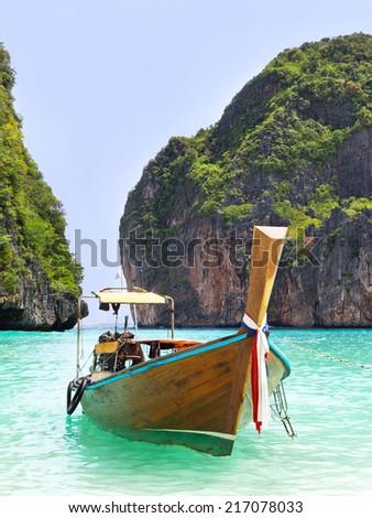 Long tail boat in Maya Bay, Ko Phi Phi, Thailand. - stock photo