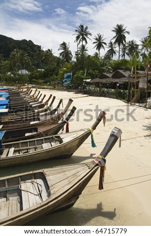 Long Tail Boats along Ko Phi Phi beach, Thailand - stock photo