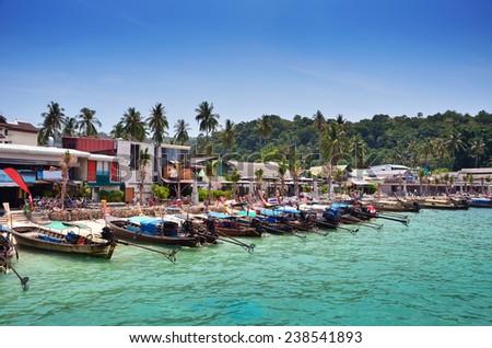 Long Tail Boats on Beach at Phi Phi Leh island, Krabi province, Thailand  - stock photo