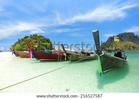 Long tail boats under blue sky in Talay Waek Krabi, Thailand - stock photo