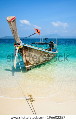 Long-tail Taxi boat on the beautiful beach and a kite,  krabi - stock photo