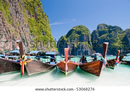 Long tail wooden boats at Maya Bay - stock photo