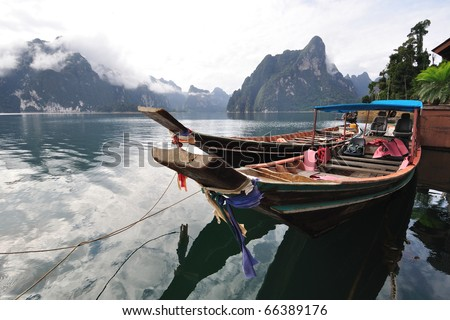 Long tailed boat floating on lake in Kho Sok national park, Thailand - stock photo