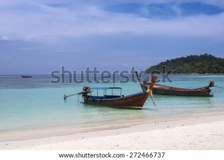 Long-tailed boat on Pattaya beach (Bundhaya) Koh Lipe Thailand - stock photo