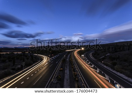 long time exposure on a highway with car light trails - stock photo
