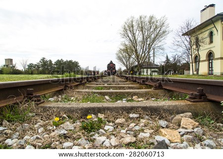 Long train rails with pebbles. - stock photo