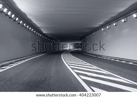 Long underground tunnel with bright lights - stock photo