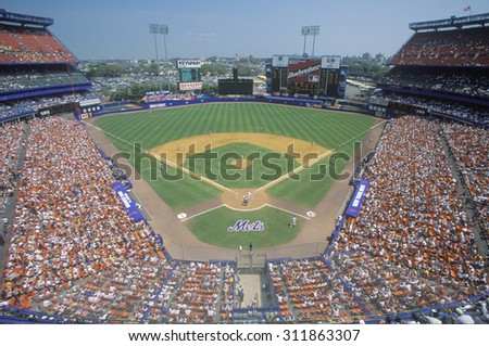 Long view of diamond and bleachers during professional Baseball game, Shea Stadium, NY - stock photo