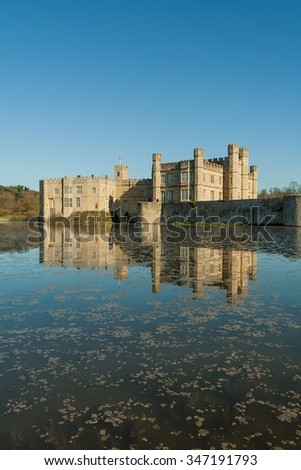 Long view of Leeds Castle with moat in foreground. - stock photo