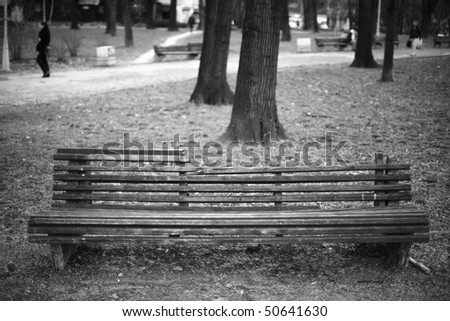 Long vintage park bench - stock photo
