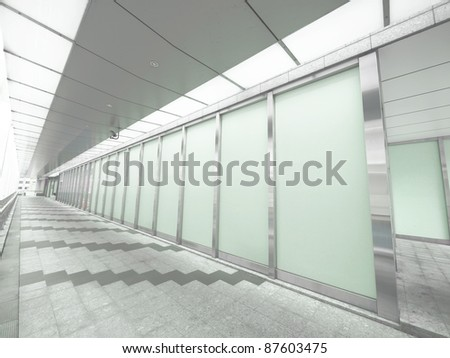Long walkway in modern building - stock photo