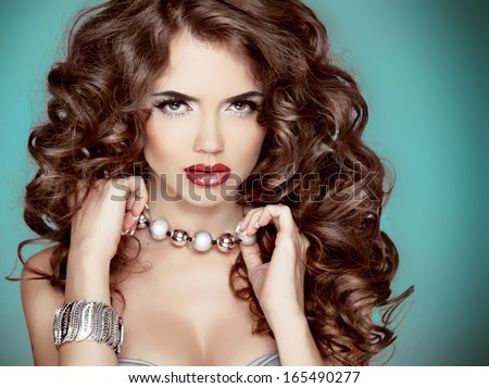 Long wavy Hair. Glamour Fashion Woman Beauty Portrait. Beautiful brunette with long curly hairstyle - stock photo
