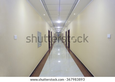 Long white corridor with the door at the end. - stock photo