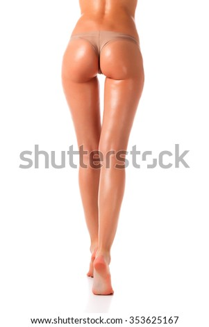 Long woman legs, isolated on white background - stock photo